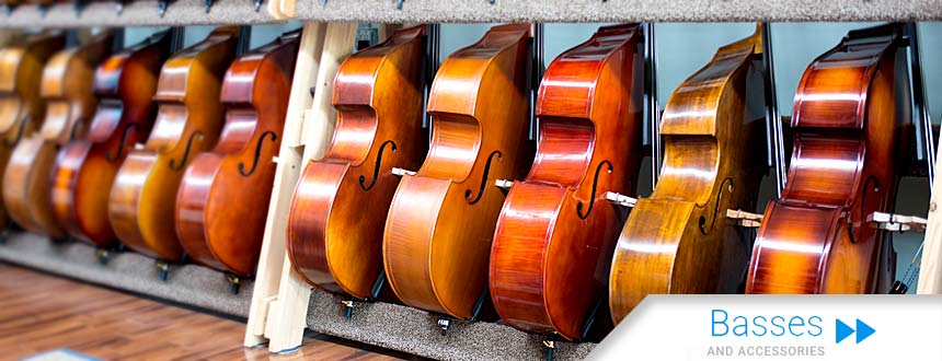 Photo showing some of the upright basses available from Top Notch Violin Store in St. Louis