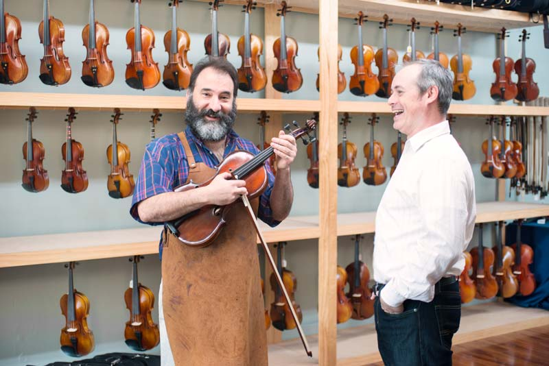 Ted and Steve with a viola in our Maplewood St. Louis store.